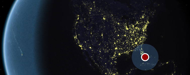 America from space with a red location dot on Florida